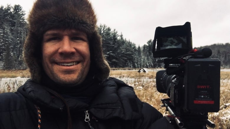 Cameraman endures extreme conditions in Canada's Arctic to film polar bear cubs emerging from their den